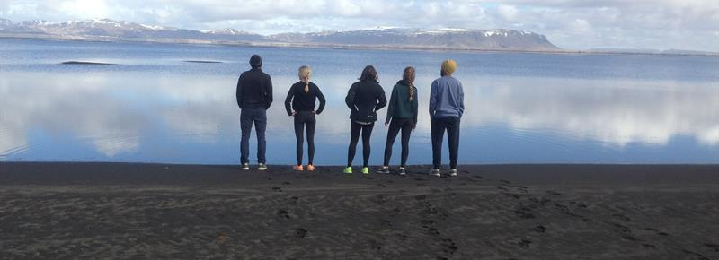 students standing by water